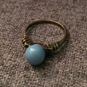 A turquoise and bronze ring